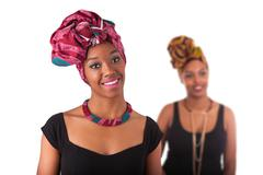 Young beautiful african woman wearing a traditional headscarf Stock Photos