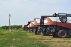 Combine harvesters, standing in a row. Agricultural machinery. - stock photo