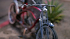 Rack Focus of a Parked Red Custom Bike. Stock Footage