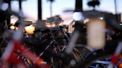 Sunset Close-Up Parked Bikes Active People in the Background Stock Footage