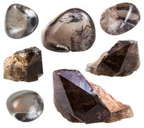 Set of smoky quartz crystals and gemstones Stock Photos