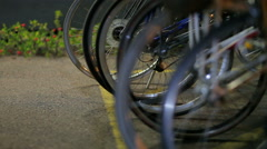 Bikes Parked in a Row Reflect Surrounding Light Stock Footage