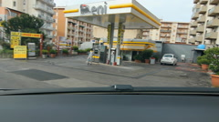 Driving Palermo. Entering Eni Petrol station for gasoline fill-up. Stock Footage