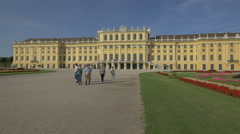 Group of tourists walking in the garden of Schönbrunn Palace, Vienna Stock Footage