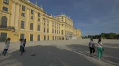 Walking and taking picturesin the courtyard of Schönbrunn Palace, Vienna Stock Footage