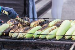 Grilled sweet corn on the charcoal stove.sensitive focus - stock photo