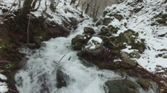 Aerial view of snowy river in forest Stock Footage