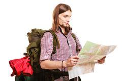 Man tourist backpacker reading map. Summer travel. - stock photo