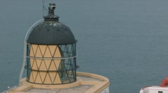 Panning scene revealing the lighthouse at St Abbs, Scottish Borders Stock Footage