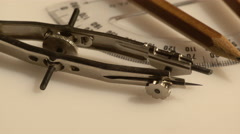 Closeup of a set of compasses and a pencil Stock Footage