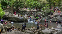Thai people Swimming in River Near Waterfall, Namtok Sai Khao National Park Stock Footage