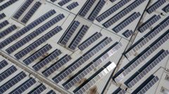 Aerial, vertical - Solar panels on top of a building Stock Footage