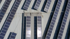 Aerial, vertical - Solar panels on top of industrial building Stock Footage
