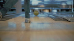 Young woman is throwing ball in a bowling club Stock Footage