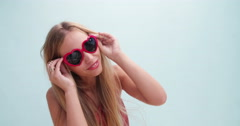 Young woman wearing big modern sunglasses Stock Footage