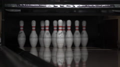 Ball rolls down a bowling lane for a strike - stock footage