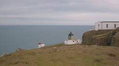 A reveal scene from the ground up of St Abbs Lighthouse, Scottish Borders Stock Footage