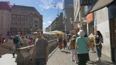 Walking by the U-Bahn station in Stephansplatz, Vienna Stock Footage