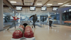 Group of people playing bowling game Stock Footage