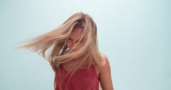 Fashionable young woman with long messy hair dancing Stock Footage