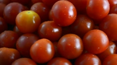 Close up macro of fresh red cherry tomatoes on turning on carousel. Stock Footage