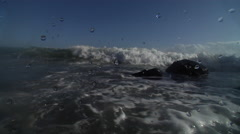 Small waves crash into lens, lots of turbulence, camera gets knocked around, Stock Footage
