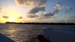 Great Barrier Reef islands at sunrise, view from boat, HD, UP24383 Stock Footage