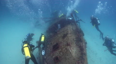Chaotic hoard of scuba divers swimming on wreckage in Australia, HD, UP24398 Stock Footage