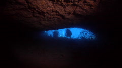 Group of scuba divers looking around in cavern in Australia, HD, UP24529 - stock footage