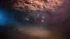 Buddy team of scuba divers swimming in cavern in Australia, HD, UP24531 Stock Footage