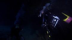 Male model scuba diver swimming in cavern in Australia, HD, UP24628 - stock footage