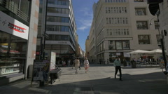 Walking on Donnergasse  cross to Kärntner Straße in Vienna Stock Footage