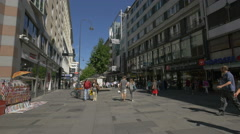 Walking near Nordsee restaurant and other stores on Kärntner Straße in Vienna Stock Footage