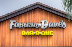 Stock Photo of Famous Dave's Restaurant Exterior and Logo