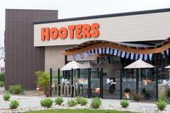 Stock Photo of Hooters Restaurant Exterior and Logo