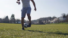 4K Unseen soccer player doing kick ups in the park - stock footage