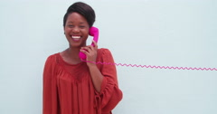 Happy woman with beautiful smile talking on the phone - stock footage
