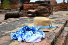 Straw hat and fabric indigo color - stock photo