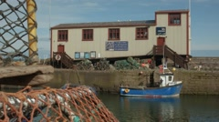 Timelapse scene of the harbour at St Abbs, Scottish Borders Stock Footage
