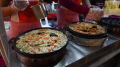 Vietnamese rice pan cake - Vietnamese Banh khot - stock footage