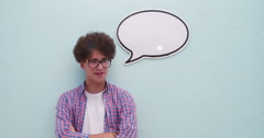 Casual young man posing with speech bubble - stock footage