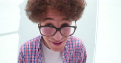Cute young man with glasses making silly faces Stock Footage
