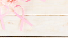 Womens health symbol in pink ribbon on a pink background. Stock Footage