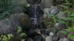 Stream water falling on rocks, super slow motion 240fps Stock Footage