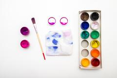 open paintbox   gouache colors with brush and palette - stock photo
