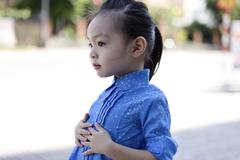 Cute lovely sweet asian chinese kid girl with smiling face on the road Stock Photos