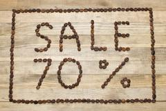 advert sale made of coffee beans - stock photo