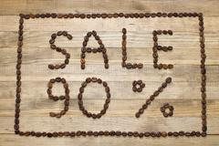 Advert sale made of coffee beans Stock Photos