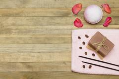 two incense sticks and pink bath bomb with soap - stock photo