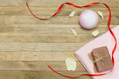 pink bath bomb and terry cloth towel  and soap - stock photo